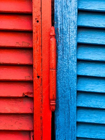 Caminito... Town Window Ventana Caminito Buenos Aires EyeEmNewHere Red Blue Pattern Full Frame No People Wood - Material Backgrounds Day Wall - Building Feature Metal Architecture Close-up Textured  Built Structure Door Entrance Outdoors Multi Colored Safety