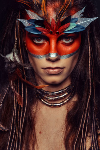 Studio portrait of a young woman with complex makeup Adult Adults Only Close-up Day Dreadlocks Dreads Face Paint Fantasy Feather  Feathers Looking At Camera One Person One Woman Only Only Women Painted Face People Portrait Young Adult