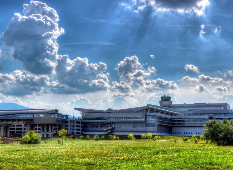 Clouds Showcase: February Green Grass Blue Sky Modern Architecture Sofia Airport Day Outdoors Building Exterior No People Architecture Airport Blue Wave The Architect - 2016 EyeEm Awards