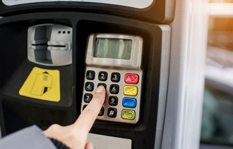 Woman finger pressing the button to paying car parking meter Human Hand Hand Technology Control Push Button Transportation Finance Number Finger Communication Keypad Control Panel Pressing Paying Park Car Cost Prize Ticket Metre Symbol Sign Process Road Street