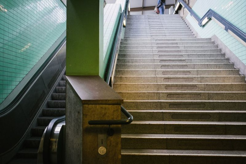 Moving vs non-moving stairs Steps Steps And Staircases Staircase Built Structure Railing Architecture Indoors  No People The Way Forward Stairs Day Hand Rail Close-up Escalator Berlin Metro Subway Station Germany Europe Retro Colors Green Blue Geometry Lines
