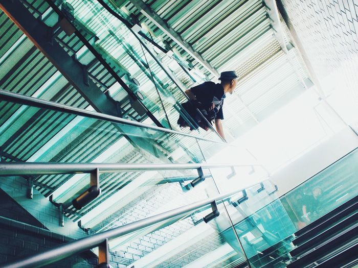 Low angle view of person walking on staircase