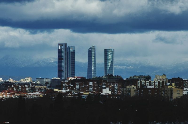 La sierra y 4 torres #madrid #madrid #callejeando City Cityscape Urban Skyline Modern Skyscraper Business Downtown District Business Finance And Industry City Life Sky Office Building