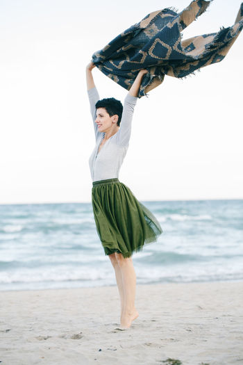Woman standing on sand at beach