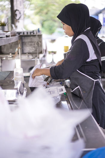 Woman preparing food at hotel