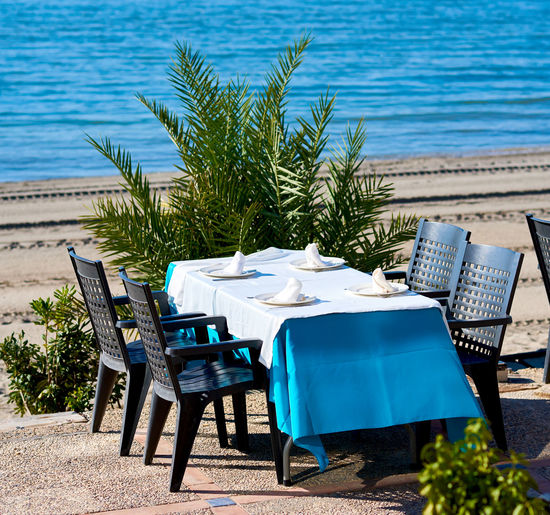 Chairs Arranged By Table At Outdoor Restaurant