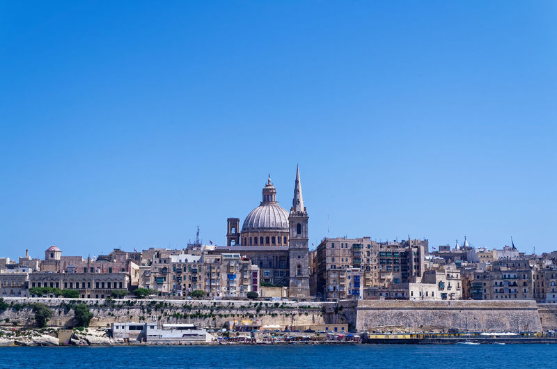 Panoramic view at Valletta city from Sliema bay Sliema Malta Valletta Building Exterior Architecture Built Structure Sky Water Clear Sky Building Copy Space City Blue Nature Travel Destinations Dome Waterfront Travel No People Day Nautical Vessel Tourism Outdoors Cityscape Canal Government Travel
