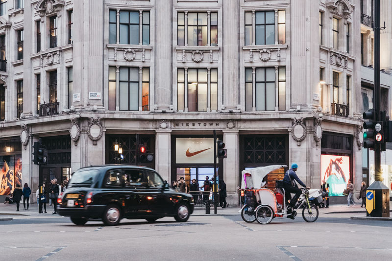London Nike Town  Taxi Architecture Black Cab Building Exterior City City Life City Street Day Mode Of Transport Outdoors Oxford Street  Real People Road Street Transportation Postcode Postcards Colour Your Horizn
