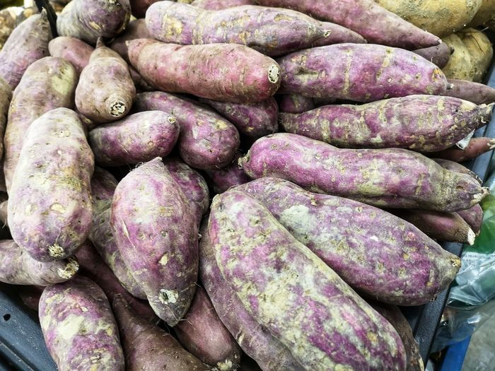 Sweet potatoes Market Backgrounds Retail  Vegetable For Sale Full Frame Close-up Food And Drink Stall Sweet Potato Various Raw Potato Farmer Market Market Stall Display Potato