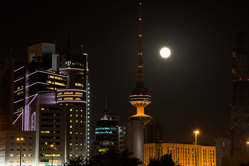 Downtown Kuwait City Architecture Building Exterior Built Structure City Communication Illuminated Low Angle View Modern Moon Night No People Outdoors Sky Skyscraper Street Light Tall - High Television Tower Tower Travel Travel Destinations
