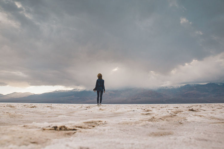Arid Climate Arid Landscape Badwater Basin Beauty In Nature Cloud - Sky Clouds Curly Hair Death Valley Death Valley National Park Death Valley, California Desert Full Length Girl Landscape Nature One Person Outdoors Real People Rear View Salt Scenics Sky Standing Storm Tranquil Scene