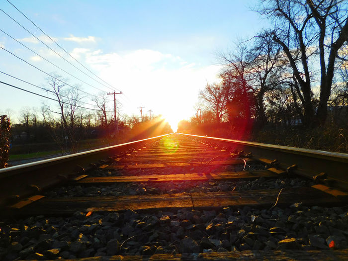 Never ending Car Connection Diminishing Perspective Lens Flare Lenshood Light Outdoors Railroad Track Road Sky Smalltown Smalltownusa Speed Sun Sunbeam Sunset The Way Forward Traintracks Transportation Travel Traveling Tree Vanishing Point Weather