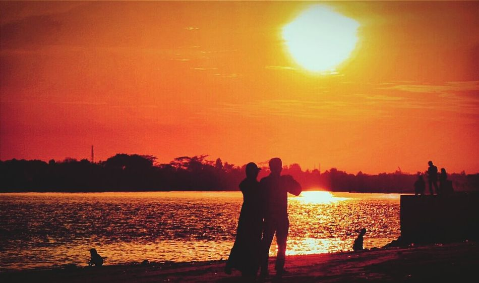 View of the sunset and random people. Impossible Moments Sunset People In Love Silhouette