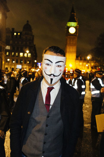Anonymous Anonymous Anonymous Mask Big Ben London Male Man Night Parliament Square Portrait Streetphotography Suit Suitedman Suitedup Up Close Street Photography