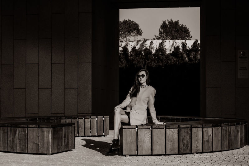 Black & White Black Background Architecture Beautiful Woman Beauty Black Black And White Blackandwhite Blackandwhite Photography Day Fashion Model Full Length Geometric Shape Lifestyles Looking At Camera One Person Outdoors People Portrait Real People Sepia Sitting Tree Young Adult Young Women