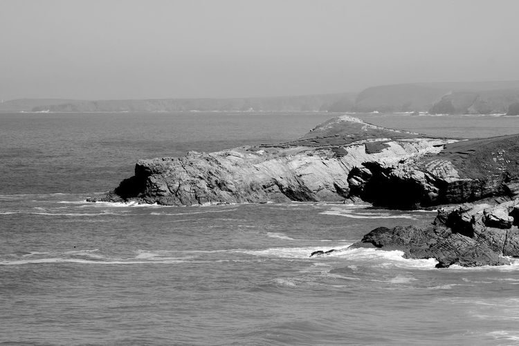 Misty Shoreline (spot the lighthouse) Sea Water Beauty In Nature Scenics - Nature Sky Rock Motion Waterfront Nature Solid Rock - Object Day Rock Formation Wave Land Beach Outdoors Tranquility Newquay Lighthouse Blackandwhite Black And White
