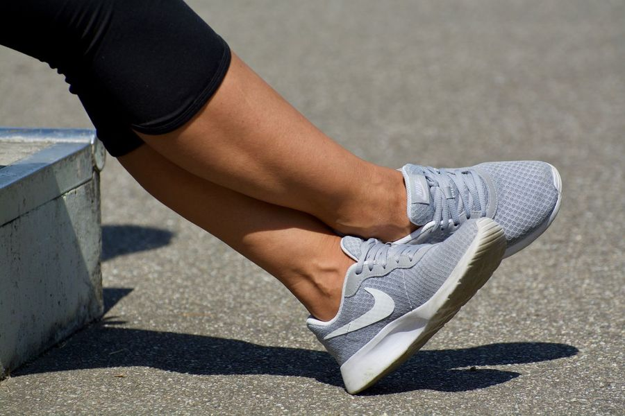 Adult Body Part Day High Angle View Human Body Part Human Foot Human Leg Human Limb Leisure Activity Lifestyles Limb Low Section One Person Real People Shadow Shoe Sport Sports Shoe Sunlight Waiting Women