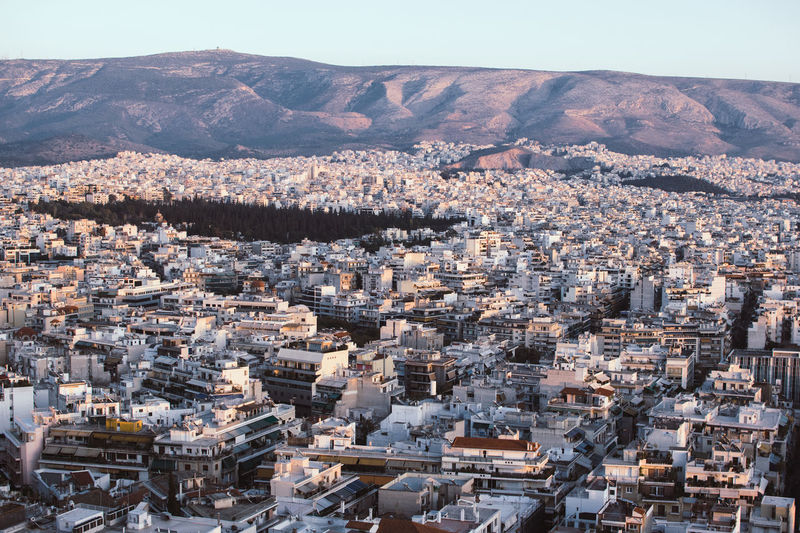 From one hill to another in Athens Aerial View Architecture Building Exterior Built Structure City Cityscape Mountain No People Outdoors Roof Sunset Travel Destinations Urban Skyline Neighborhood Map The Architect - 2017 EyeEm Awards Lost In The Landscape An Eye For Travel Stories From The City Go Higher