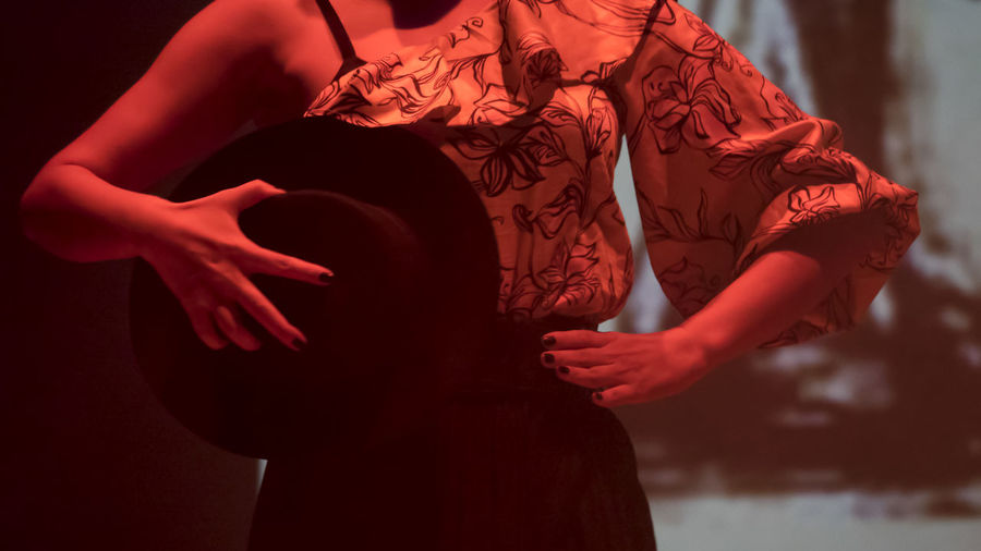 Midsection of woman dancing on stage