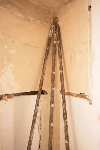 Low angle view of ladder by building