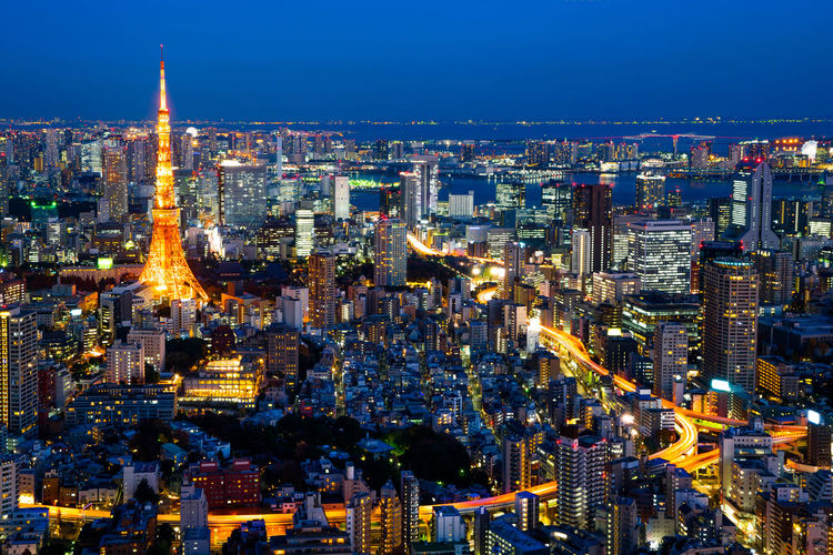 Asia Business concept for real estate & corporate construction - panoramic modern city skyline of Tokyo Tower with neon night in Roppongi Hill, Tokyo, Japan Architecture Bird Eye View Business City Cityscape Financial District  Japan Modern Panoramic Skyline Tokyo Tower UB Aerial View Blue Sky Building Corporate Construction Landmark Light Trail Mori Neon Night View Real Estate Roppongi Hills Skyscraper Tracks