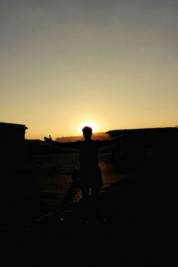 Silhouette Adult One Person Sky StandingFree From Stress Lost In The Landscape Be. Ready. Outdoors Sillouette Sunlight Lost In History