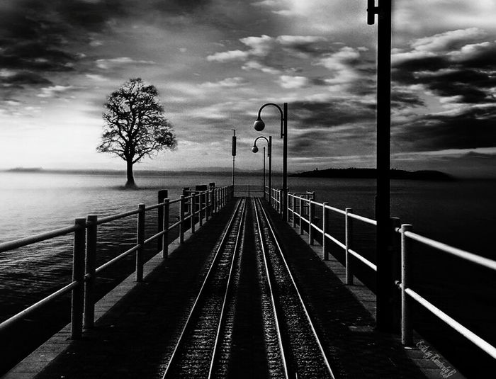 Surrealism Water Railing DreamScapes Cloud - Sky Non-urban Scene Diminishing Perspective Surreal Blackandwhite Grayscale Traintrack ... End Of The Line. I used three separate photos for this one surreal picture. Partial photo and full edit by me.