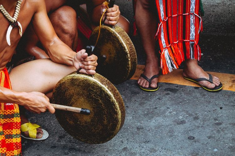 High angle view of men playing gong on road