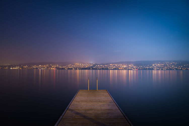 Clear Sky EyeEmNewHere Nightphotography Reflection Tranquility Zürich Blue Citylights Cityscape Clear Sky Illuminated Lake Lake View Long Exposure Nature Night Outdoors Pier Reflection Reflections In The Water Sky Swiss Switzerland Tranquil Scene Water
