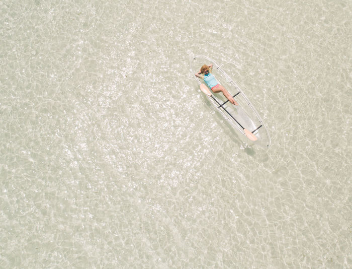 Aerial view of woman kayaking in sea