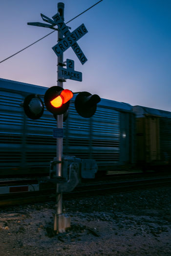 Sign Rail Transportation Transportation Guidance Communication Mode Of Transportation Signal Railway Signal Public Transportation Railroad Track Track Train Sky Railroad Crossing Illuminated Train - Vehicle No People Outdoors Nature Light Crossing Sign
