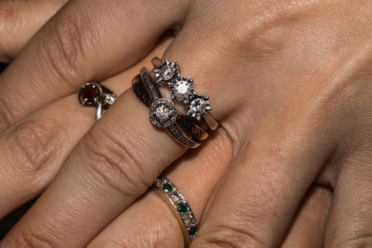 Cropped image of woman hands showing rings