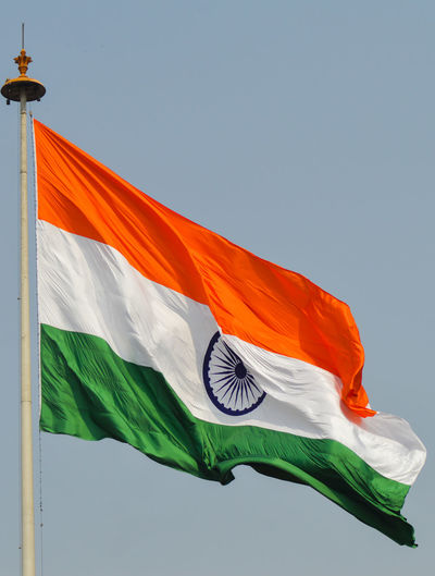 Low angle view of indian flag against sky