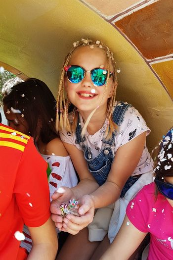 Festival time Blonde Girl Blonde Hair Hairstyle Sun Glasses Festival Festival Season Festive Mood Festive Decor Blondy Confetti Young Women Portrait Sitting Beautiful Woman Looking At Camera Youth Culture Summer Arts Culture And Entertainment Fashion Springtime Decadence
