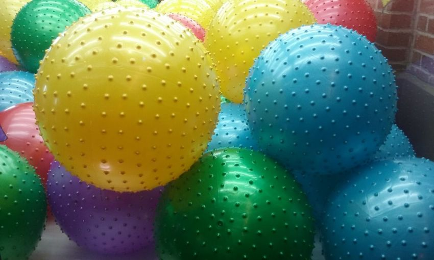 Vibrant Color No People Blue Colorful Multi Colored Balls Kids Toys Toy Photography Man Made Object Green Color Retail  Large Group Of Objects Textures And Surfaces Textures Texturestyles Stack Toy Machine Bouncy Ball Bouncy Yellow Yellow Ball Variety