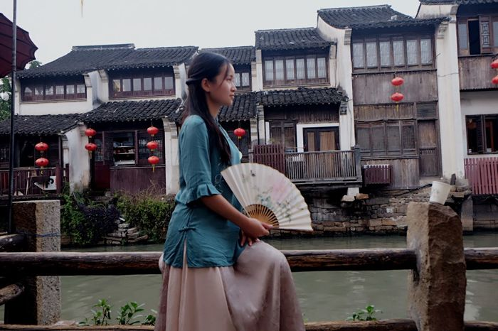 Chinese Style Chinese Paintings Folding Fan Architecture One Person Building Exterior Women Built Structure Three Quarter Length Casual Clothing Lifestyles Young Women City