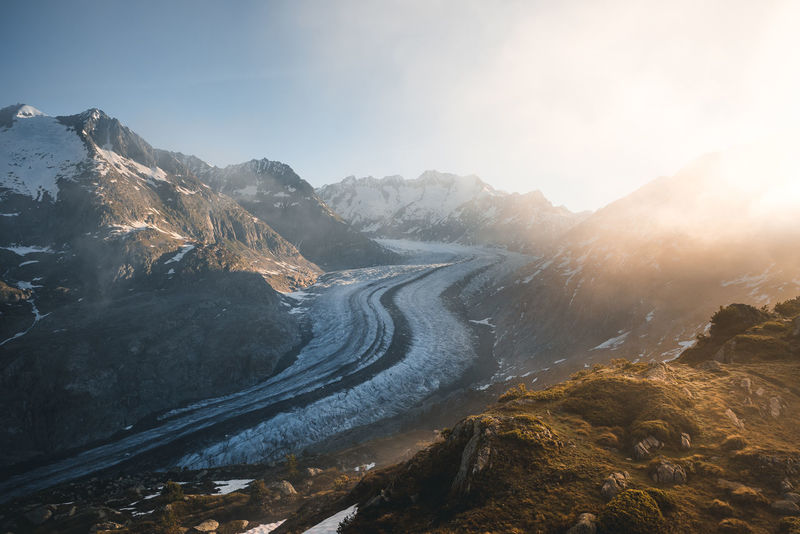 Amazing sunrise at the Aletsch Glacier with the sun shining into the fog. Aletsch Glacier Hiking Morning UNESCO World Heritage Site Beauty In Nature Cold Temperature Environment Fog Glacier Idyllic Landscape Mountain Mountain Range Nature No People Non-urban Scene Outdoors Scenics - Nature Sunlight Sunrise Switzerland Tranquil Scene Tranquility Water Winter The Great Outdoors - 2018 EyeEm Awards