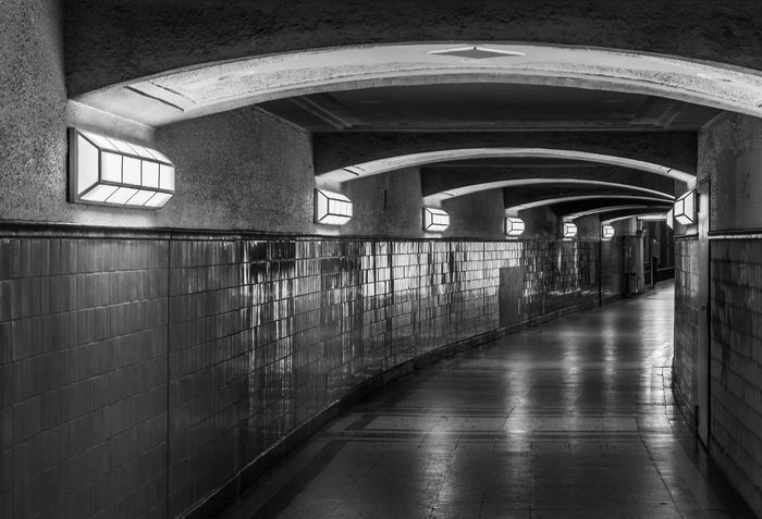 Black & White Black And White Reflection Futuristic Underpass Heidelberger Platz U-Bahnhof Underground Station  Built Structure Architecture Direction The Way Forward Indoors  No People Arch Wall - Building Feature Illuminated Flooring Absence Tunnel Lighting Equipment Arcade Ceiling Wall Empty Tile