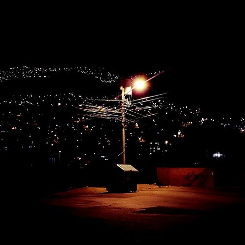 Trash bin in La Paz - Bolivia at night Trash Bin Light Posts Cables And Wires Night Illuminated Outdoors No People Long Exposure Sky