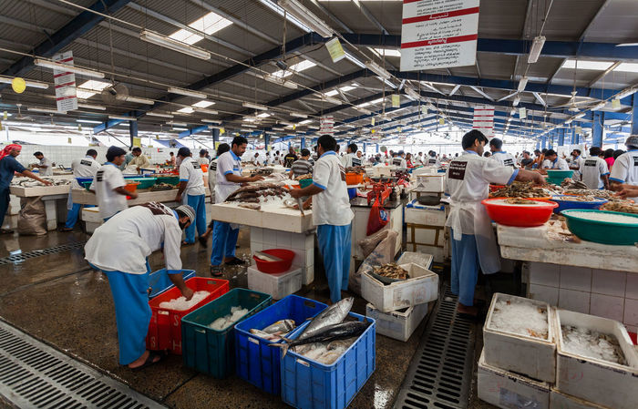 Marina Dubai Deira Fish Market Men Large Group Of People Group Of People Real People Food Occupation Market Standing Adult Crowd Women Food And Drink Indoors  Working Freshness Retail  Seafood Business Market Stall Fish Market