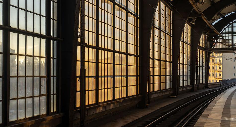 Railroad station platform seen through window