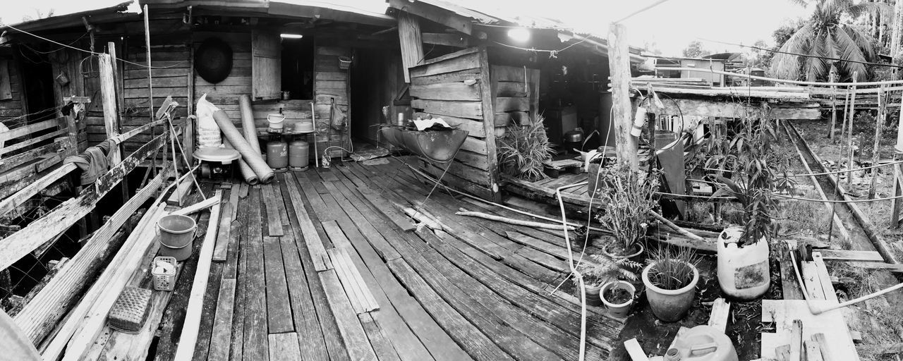 Longhouse wooden back porch. An old style wooden longhouse that still on stilts and with the common layout where the kitchen would lead out to a back porch where barbecues and small gatherings still occur. Built Structure Industry No People Architecture Indoors  Day