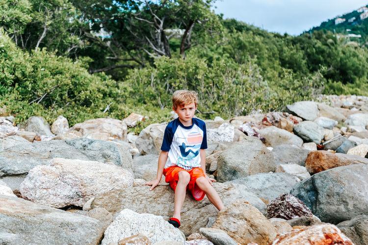 Portrait of boy standing on rock