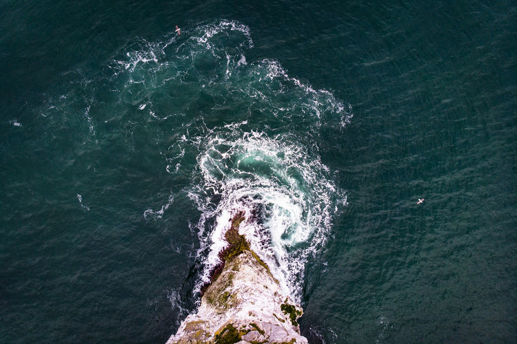 Causeway Coast near Giant's Causeway without tourists aerial view of waves and basalt Shot United Kingdom Causeway Coast Northern Ireland Drone Photography Dronephotography Aerial View Aerial Photography EyeEmNewHere Water Sea Motion No People Beauty In Nature High Angle View Day Nature Outdoors Scenics - Nature Wave Rock Splashing Tranquility Land Turquoise Colored