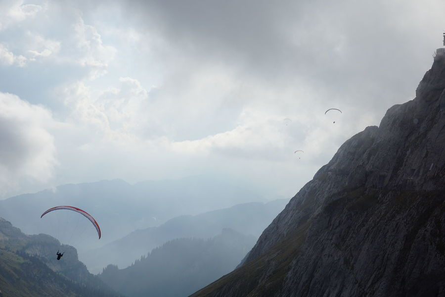 I want to break fee, Location: Mt. Pilatus Pilatus Mt. Adventure Beauty In Nature Day Extreme Sports Flying Leisure Activity Lifestyles Mid-air Mountain Mountain Range Nature Outdoors Parachute Paragliding Real People Scenics Sky Tranquility