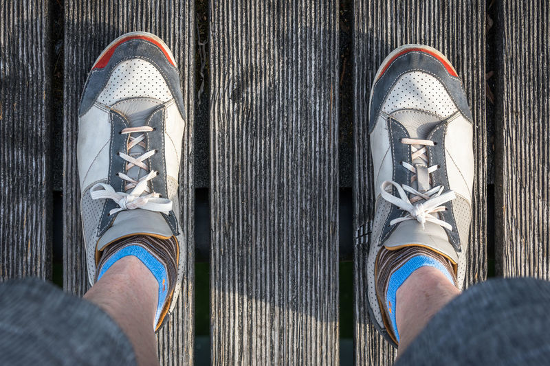Adult Adults Only Close-up Day Directly Above Feets Footsie Human Body Part Human Leg Landing Page Lifestyles Low Section Men Moma One Man Only One Person Only Men Outdoors Outfit People Shoe Shoes Shorts Standing Wood - Material