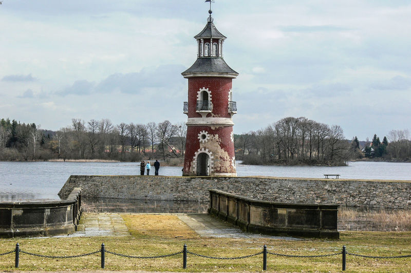 lake and castle Moritzburg in Saxony Castle Winter Architecture Bare Tree Beauty In Nature Building Exterior Built Structure Cloud - Sky Day Grass History Lake Leisure Activity Lighjttower Nature Outdoors Real People Sky Travel Destinations Tree Water