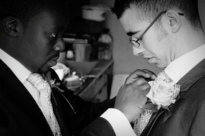 Best Man Fixing Tie Of Groom
