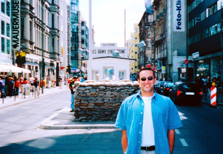 EyeEm Selects Building Exterior Street City Architecture Built Structure Looking At Camera One Person Outdoors Portrait Real People Day Smiling Standing Young Adult One Man Only Adult Adults Only People Only Men Sky Checkpoint Charlie  Checkpoint Charlie Berlin  Ryan Craig