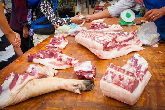 Bones Butcher Butcher Shop Market Raw Meat   Slaughter Animal Butcher Butcher's Trade Butchered Buying Meat China Cutting Food Holding Human Body Part Kitchen Knife Meat Meat Market Pig Pigs Feet Pork Selling Selling Meat Selling On The Street The Street Photographer - 2018 EyeEm Awards The Traveler - 2018 EyeEm Awards